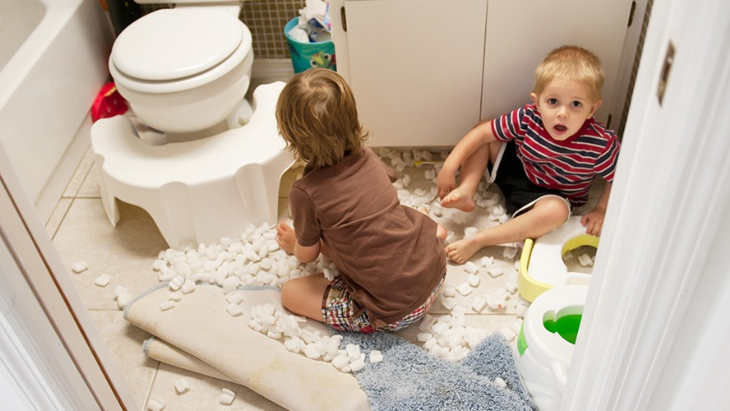 Naughty kids making mess in the bathroom