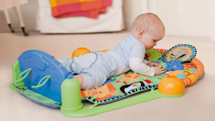 9eb887c5b160b Babies will love this super interactive Piano Gym. Start off easy and have  them lay down and kick to activate the piano and bat at the dangling toys.