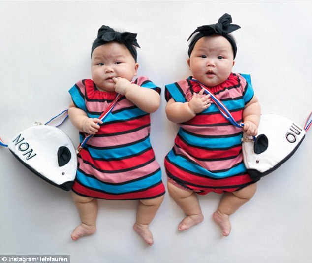 twins with bags