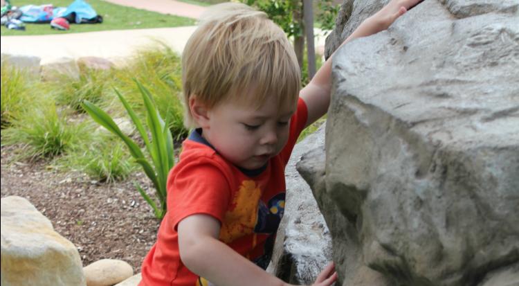 boy climbing rock